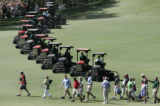 AUH234 - Patrons leave the course as groundskeepers start mowing the eighth fairway Wednesday,...