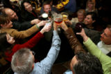DLM1435  A group of Qwest employees raise their glasses in a celebratory toast at the Rocky...