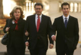 Former Qwest CEO Joseph Nacchio, center, walks with his wife Anne Esker (cq) left, and son Michael...