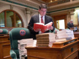 Rep. Cory Gardner, R-Yuma,  found his desk on the Capitol floor filled with law books as a part of...