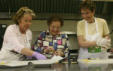 Nikki Rossi (cq), Mary Rotola, (cq), 93, and Carol Rondinelli (cq), left to right, work on honey...