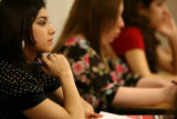 Arrupe Jesuit High School senior Erlinda Ramirez, cq,18-year-olds, listens to her teachers...