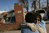 MJM108 Rene Denis (cq), center, hugs her mother, Nellie Garcia (cq), right, outside Denis'...