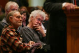 A spectator listens to State  Senator Ron Tupa-D makes his opening remarks as he speaks at a...