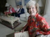 Lou Harrel, (cq) 80 holds a copy of her story and brings some of her friends including Dee...