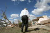 MJM907 Colorado Governor, Bill Ritter, left, walks a portion of the effected area Thursday in...