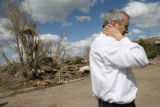 MJM890 Colorado Governor, Bill Ritter, left, walks a portion of the effected area Thursday in...