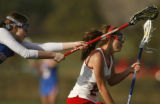Cherry Creek's Keri Rattiner, left, chases after Kent Denver's Kara Secora, right, in the second...