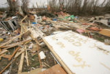 "Spraypaint on a wall says ""Thank you God, We are okay,"" amidst debris in Holly, Colo.,..."