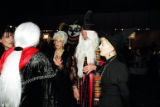 Jan and Ross Wilkins discuss the rules of the auction with Linda Chowdry and Maureen and DC...