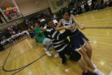 Adam Muniz, left foreground in stripe shirt, pulls in a tug of war with Patricia Gonzalez, right...