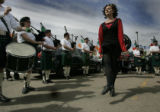 Surrounded by members of the Michael Collins Pipe and Drum Caitlin O'Connor Shobe does her Irish...