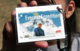 Christina Rogue (cq) a seventh grader at Kepner Middle School holds a souvenir laminated Everest...