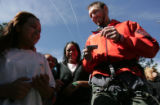 Kepner Middle School teacher and mountaineer Mike Haugen, 30, autographs laminated Everest...