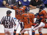 Colorado Crush wide reciever  Willie Quinnie, left, celebrates his 13-yard touchdown game tieing...