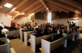 Bishop Robert Shaheen, welcomes and praises the congregation during the Dedication and...
