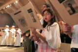 Natalie Homsi (cq)joins her congregation in prayer during the Dedication and Consecration...