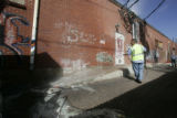 Emilio Sisneros (cq) a maintenance tech for Denver cleans graffiti off of a building in the 2700...