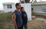 Neighbors Albert Sena (cq), left, and his wife Rosanne Sena (cq), talk to a reporter, at the scene...