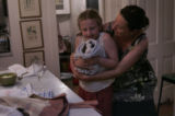Deb Belk hugs Migle Prekeryte,8 with her guinea pig Saggy after their dinner in Littleton on...