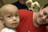 (DENVER, Colo., March 23, 2005) Yarely Peralta,2, (cq Yarely Peralta from mother through...