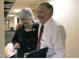 Rep. Tom Tancredo puts his arm around his wife Jackie after he announced his candidacy for...