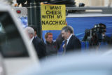 Tina Tusa (cq), a concerned citizen, shows a sign in relation to the court case involving Joe...