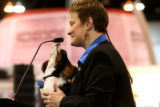 Tommy, a 7 month old Cavalier King Charles Spaniel, at a press conference with Robin Downing (cq),...