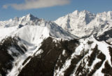 Pyramid Mountain, back left, and Maroon Bells, back right, provide a spectacular backdtop to Aspen...