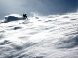 Photograph by Neal Beidelman of unidentfied skier in the powder on Highland Bowl in Aspen, Colo....