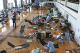 An overview of the ballroom shows a space taken up by approximately 60 beds for donating blood....