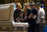 DLM1114  Friends of Samara Stricklen gather in front of her casket to pay their respects during...