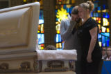 DLM1116  Friends of Samara Stricklen gather in front of her casket to pay their respects during...