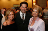 Auction chairwoman Tara King, left, with golf tournament founder Aaron LaPedis, center, and former...