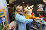 Diana Nelson, (cq), within Kazoo and Company dances with Arthur, one of her favorite stuffed...