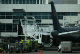 A United Airlines aircraft sits at Gate B22 surrounded by emergency crews and airport officials at...