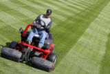 DLM1823  James Sowl mows the outfield grass at Coors Field in preparation for the Rockies' opening...