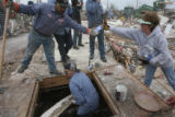 (at center) Greg Martinez (cq) from Ranco Trailers and Construction helps out on the clean-up...