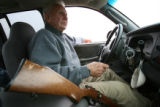 MJM859 Rancher, Bill Lowe (cq) carries 22 caliber rifle in his truck Friday in order to put two...