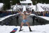 Mark Borrar celebrates his jump iin the 2007 Spring Splash event for the last day of skiing at...