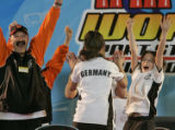 Head coach of team Germany Burkhard Reuhl, left, and David Wolf, right, celebrate defeating team...