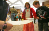 (from left) Sara Frosch, 7, and Oliver Greenwald, 5, scroll a copy of their own version of the...