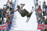 Skier Sam Tilly jumps into the pool for the 2007 Spring Splash event for the last day of skiing at...