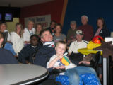 Ron Gulick and his son Jack,  surrounded by participants and Craig Hospital staff.  Ron Gulick...