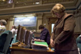 DLM9094  Rep. Nancy Todd, D-Aurora, and the other Colorado representatives bow their heads in a...