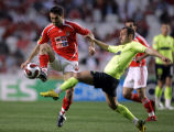 XAF102 - Benfica's Karagounis, left, from Greece, goes for the ball with Braga's Castanheira...