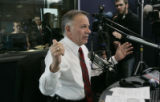 Surrounded by the media, Rep. Tom Tancredo announced his candidacy for president on radio show...