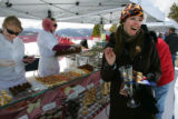 Kate Sheldon (cq), right, of Edwards delights in the desserts from The Game Creek Club at the...
