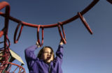 Addie Cavallaro (cq), 7, a first grader at Grant Ranch K-8, plays on the jungle gym on the school...