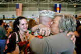 DLM3880  Lance Cpl. P.J. Van Dyk of Denver gets a hug from his mom Madeline Van Dyk after arriving...
